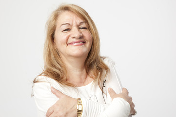 senior woman smiling over a white background