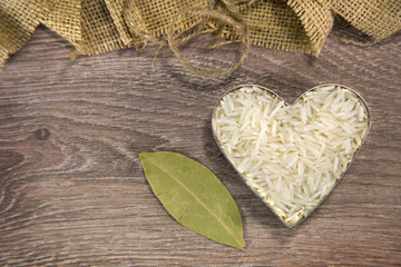 Heart-shaped rice with bay leaf