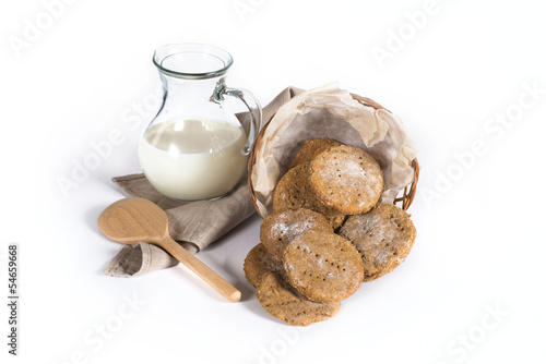 Milk jar and Finnish cookies on white background