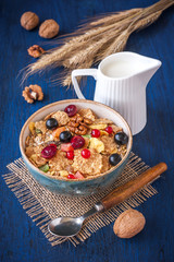 Granola cereal with fresh berries, currants and gooseberries.