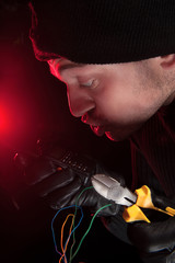 Cutting the wires. Close-up of frustrated burglar cutting the wi