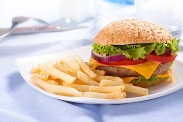 Fast food eat. Burger and French Fries on the plate.