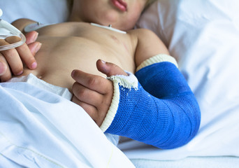 Little boy in hospital with broken arm just came back from surge