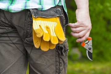 Man with gardening shears in hand