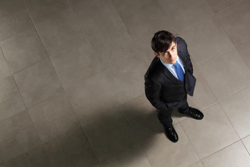 Young businessman looking above