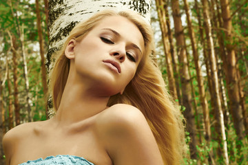 beautiful blond girl in the autumn forest