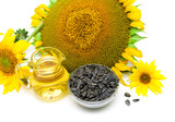 oil and sunflower seeds on white background