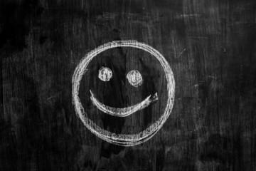 Smiley face drawn on blackboard