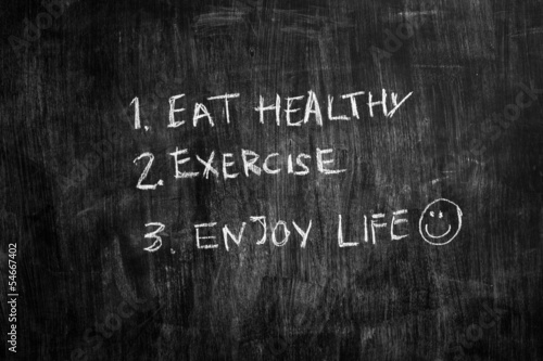 Eat healthy and exercise written on blackboard