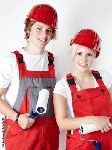 Two painter apprentices are happy to get a job