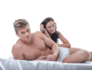Image of pretty young couple posing in bed
