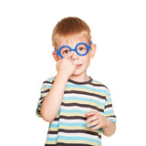 Little boy adjusting his glasses. Isolated on white