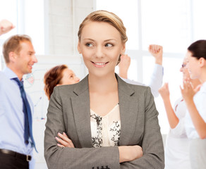 businesswoman celebrating succes in office