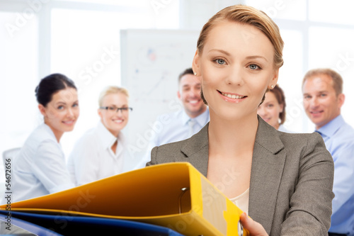 woman with folders in office