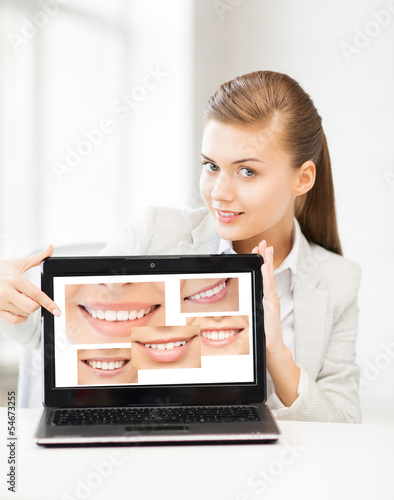 woman with laptop and smiles