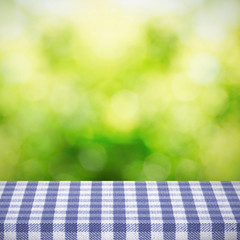 Table with cloth over bokeh background
