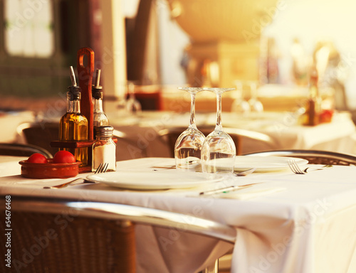 canvas print picture Restaurant table at sunset