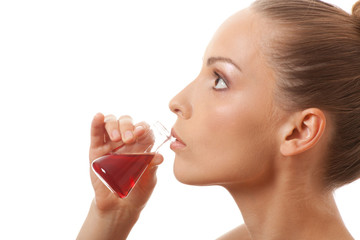 woman drinking a red liquid