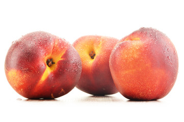 Three fresh nectarines isolated on white background