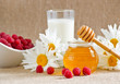 Honey, milk, raspberries  and daisies