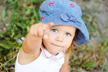 toddler girl pointing with finger