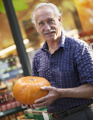 senior man and Halloween Shopping