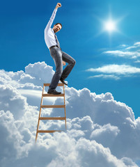businessman high in the sky reaches the top