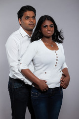 Young romantic indian couple. Wearing white shirt and jeans. Stu