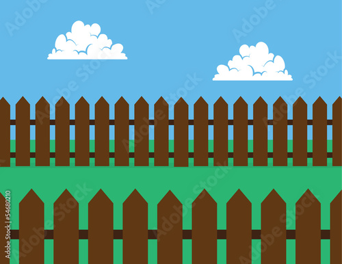 Brown wooden picket fence in backyard