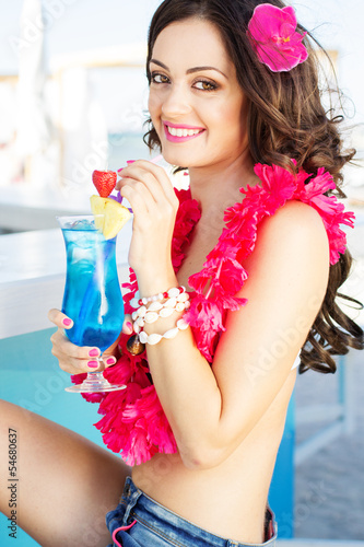 beauty young woman on the beach bar