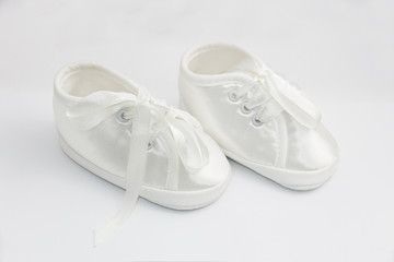 Little shoes for baptism infant.