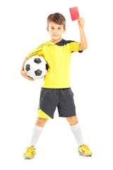Kid in sportswear holding ball and red card