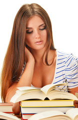 Young woman reading a book. Female student learning