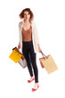 Portrait of a beautiful young woman posing with shopping