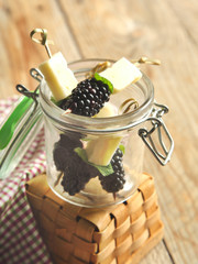 Fruits, cheese and herb skewers