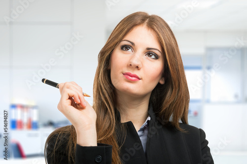 Business woman holding a pen