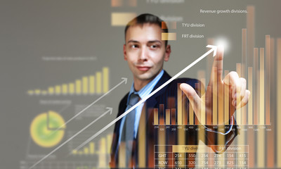 Young businessman touching icon