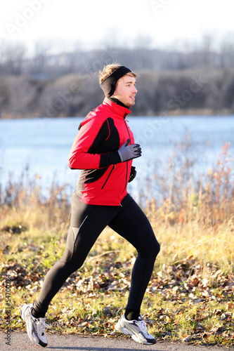 Running man jogging in autumn outdoor