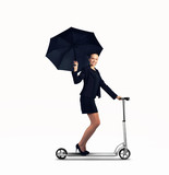 Businesswoman riding scooter