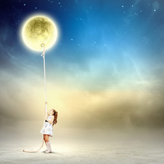 Little girl pulling moon