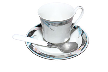 Floral teacup with saucer and spoon isolated
