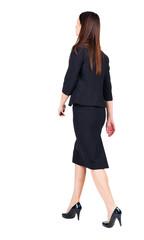 walking business woman. back view.