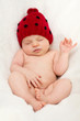 Baby girl with a red hat