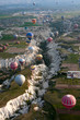 Hot air balloons rise over valley in Cappadocia, Turkey