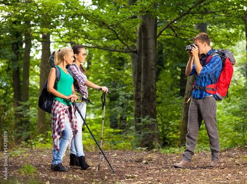 Young man take picture of his friends