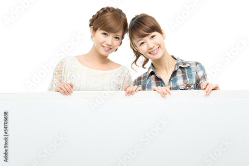 Beautiful asian women with white board.