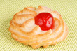 Almond pastry with candied cherry