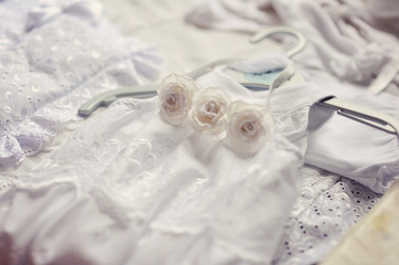 beautiful white dress and bonnet for a newborn baby