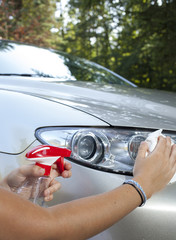 Cleaning car headlamp, close up