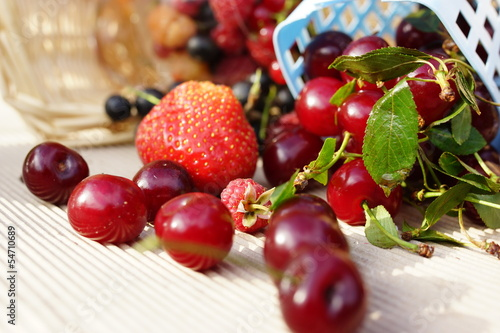Sweet summer berries: strawberries, cherry, currant, raspberry